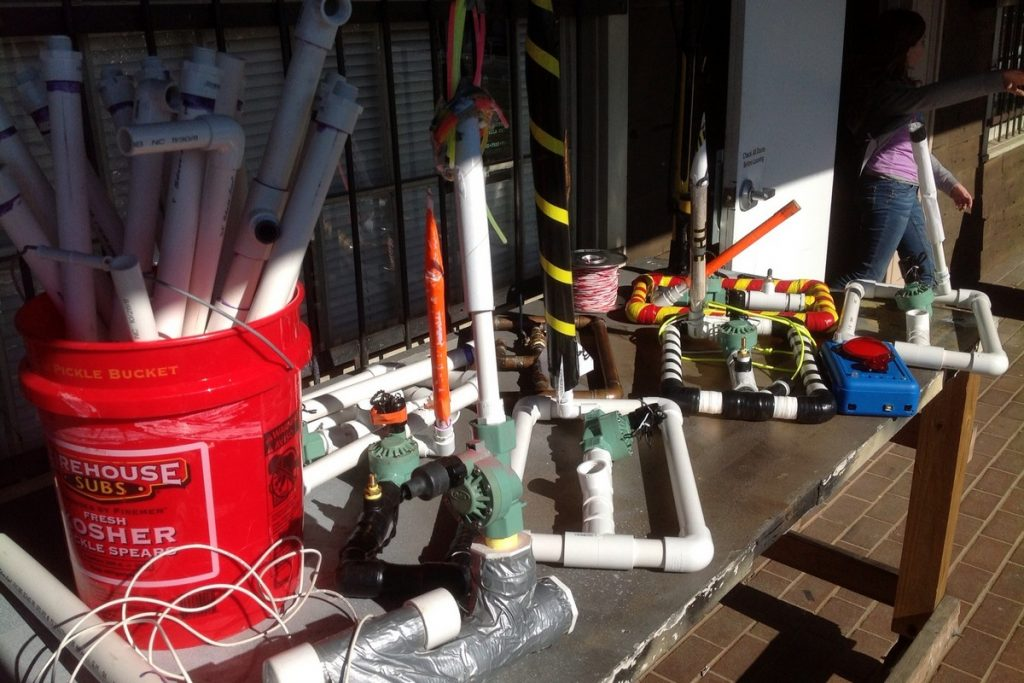 5 or more compressed air rockets launchers on a table