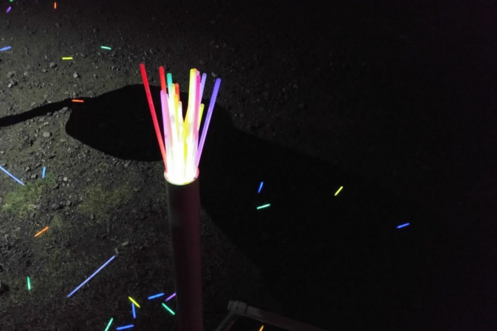 25 glow sticks loaded haphazardly in a 2 in tube