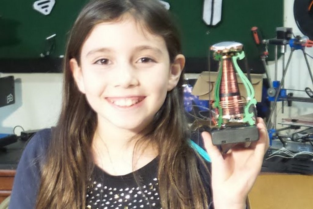 Young girl shows off a mini tesla coil that she just made