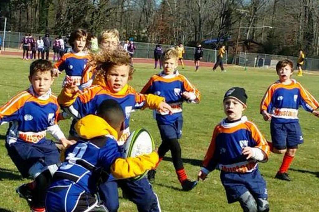 Kids rugby team converges on single oppoent