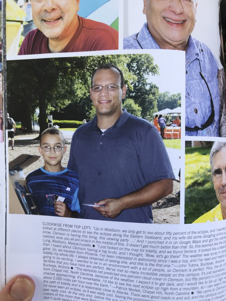 Photo of a page from a book - Eclipse Over Clemson - With a father and son